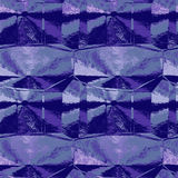Abstract crumpled violet and blue pattern resembling metal foil Stock Images