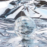 Abstract crystal ball. On foil background Stock Photo