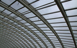 Abstract of a curved glass roof. The roof of a giant greenhouse, from inside the structure Stock Images