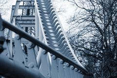 Abstract curved steel structure of silvery color. For an attraction in park under the open sky Stock Photo