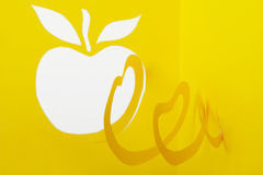 Abstract cutout yellow paper apple Stock Photo