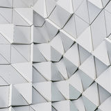Abstract 3d illustration architectural pattern. Abstract 3d illustration of modern aluminum ventilated facade of triangles Royalty Free Stock Image