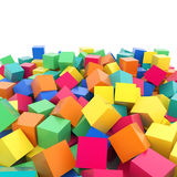 Abstract 3d rainbow colored cubes on white background. Colorful abstract 3d plastic rainbow reflective cubes composition on white background Royalty Free Stock Image