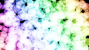 Abstract 3D render bokeh background with rainbow-color gradient. On black background Royalty Free Stock Images