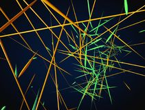 Abstract 3d rendering of chaotic green and orange lines on a dar Royalty Free Stock Images