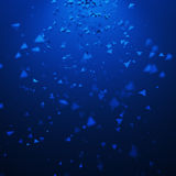 Abstract 3D Rendering of Flying Particles. Abstract 3d rendering of blue chaotic particles. Background with pyramids in empty space Royalty Free Stock Photography