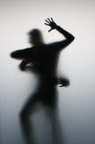 Abstract: Dancing. Shadows, dancing, behind matte glass Stock Photo