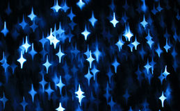 Abstract dark background with blue and white stars Royalty Free Stock Image