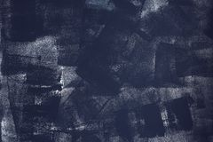 Abstract dark background of dry brush strokes on the wall. Grunge texture of interior surface stock photography