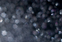 Abstract dark background with hexagons bokeh Royalty Free Stock Photos