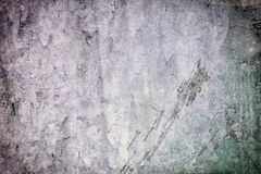 Abstract dark background for layout. Old plastered wall with cracks, scratches and stains. stock image