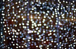 Abstract dark background with white bokeh Royalty Free Stock Images
