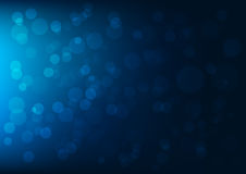 Abstract dark blue bokeh background Stock Images