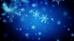 Abstract dark blue Christmas background of defocused snowflakes stock video