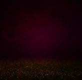 Abstract dark bokhe lights background , purple,black and subtle gold. defocused background Stock Image