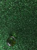 Abstract dark green vertical background with green ball royalty free stock photography