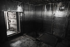 Abstract dark grungy industrial interior Stock Photos