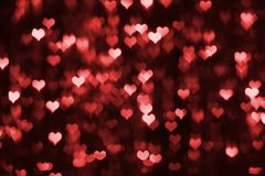 Abstract dark valentine background with red hearts Royalty Free Stock Image