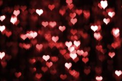 Abstract dark valentine background with red hearts Royalty Free Stock Images