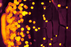 Abstract darken background with blur warm lamps Royalty Free Stock Images