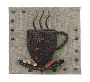 Abstract de mokconcept van koffiebonen over de achtergrond van het jutecanvas Stock Afbeeldingen