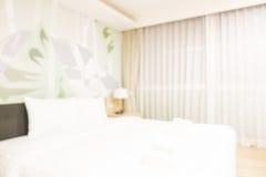 Abstract de slaapkamerbinnenland van het onduidelijk beeldhotel Stock Afbeeldingen
