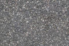 Abstract de steenpatroon van de close-upoppervlakte bij de zwarte geweven achtergrond van de steenmuur Stock Foto