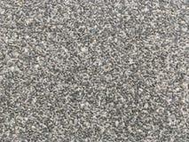 Abstract de steenpatroon van de close-upoppervlakte bij de zwarte geweven achtergrond van de steenvloer Stock Foto's