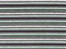 Abstract de stoffenpatroon van de close-upoppervlakte bij het donkergroene stoffentapijt bij de vloer van de achtergrond van de h Royalty-vrije Stock Foto