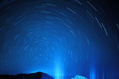 Abstract decorative background with traces of stars against the night sky. Shot long exposure stock photography