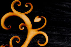 Abstract decorative wooden tree on black background Stock Photos