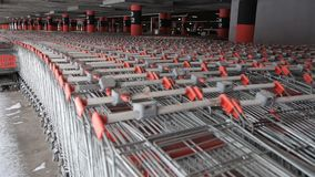 A lot of shopping carts. Abstract defocus blurred of consumer goods in supermarket grocery store., Business retail and customer shopping mall service., Motion stock video footage
