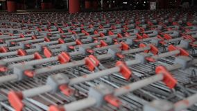 A lot of shopping carts. Abstract defocus blurred of consumer goods in supermarket grocery store., Business retail and customer shopping mall service., Motion stock footage