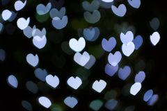 Abstract defocus heart shape light bokeh background Royalty Free Stock Image