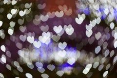 Abstract defocus heart shape light bokeh background Stock Photos