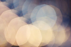 Abstract Defocused Bokeh light vintage background. Soft Beautiful blurred backdrop with blue and golden lights. stock photography