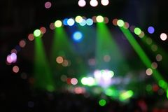Abstract defocused color spotlights on concert royalty free stock photos