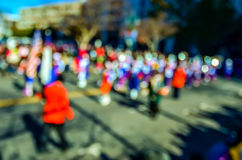 Abstract and defocused image of a thanksgiving parade in a big c Royalty Free Stock Image