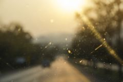 Abstract defocused of light on the mirror of car driving on road Royalty Free Stock Photography