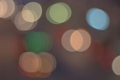 Abstract defocused lights bokeh as light car on road background Stock Photos
