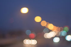 Abstract defocused lights bokeh as light car on road background Stock Images