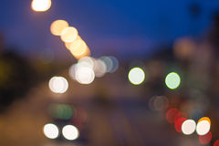 Abstract defocused lights bokeh as light car on road background Stock Photography