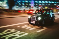 Abstract defocused in motion British Taxi hackney carriage cab d Stock Photography