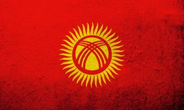 The Kyrgyz Republic Kyrgyzstan National flag. Grunge background vector illustration
