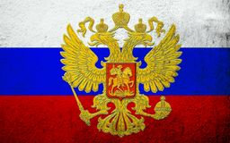 National flag of Russian Federation with Coat of arms. Grunge background stock illustration