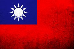 The Republic of China Taiwan National flag `Blue Sky, White Sun, and a Wholly Red Earth`. Grunge background stock illustration