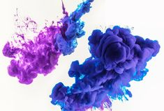abstract design with smoky splashes of blue and purple paint in water, isolated on white royalty free stock photography