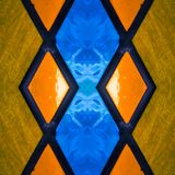 Abstract design with stained glass in blue and orange colors, background and texture. Backdrop for colors related ads, geometric pattern with reflection effect royalty free illustration