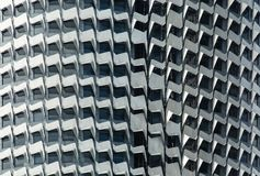 Abstract detail of the aluminum fins decorating the front facade of building stock images
