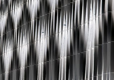 Abstract detail of steel vertical curved cladding. On a modern hi-tech development Royalty Free Stock Photography